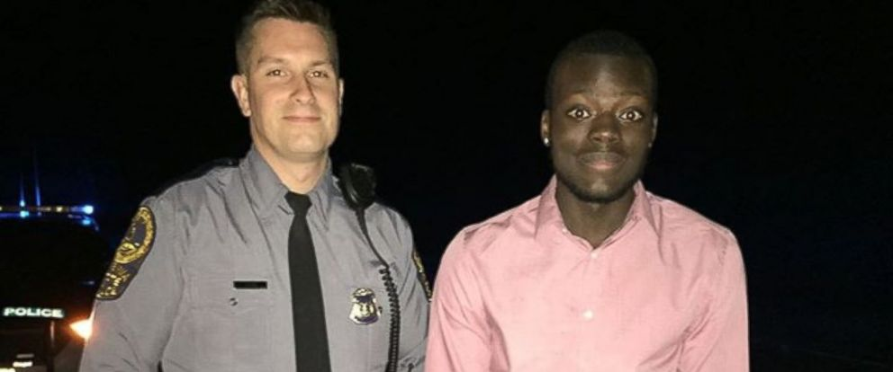 """PHOTO: According to a post on Facebook, Dr. Owusu wrote that Virginia State Trooper Matt Okes """"got on his knees to replace his tire"""" and """"provided all the needed protection"""" until 2 a.m."""