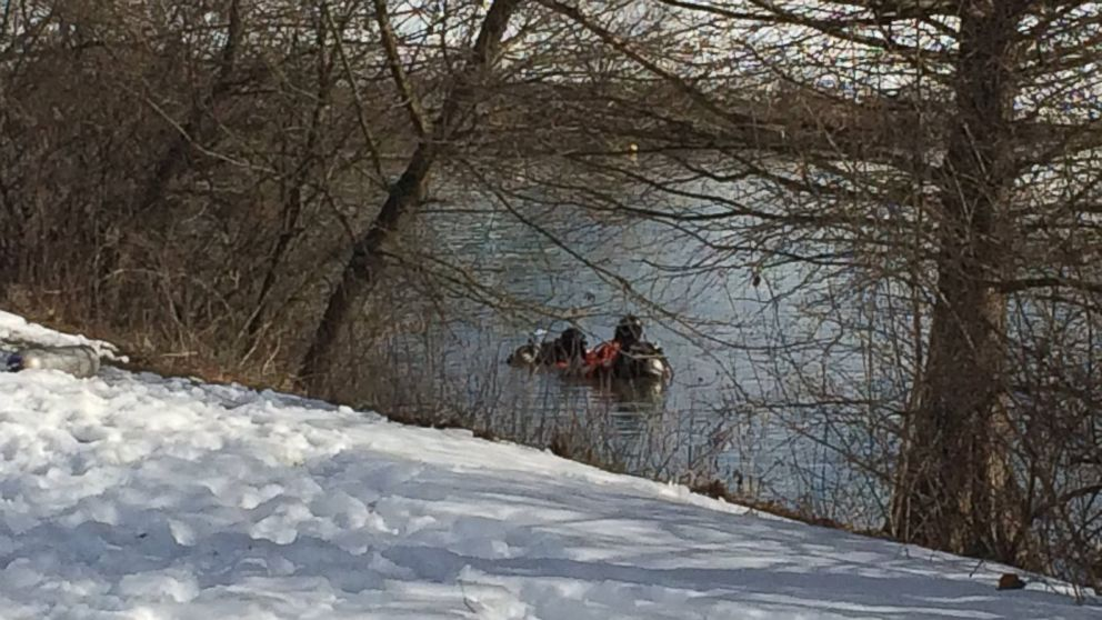 The Virginia State Police Search & Recovery Team divers searched a pond on the Virginia Tech campus in connection to the abduction/murder of Nicole Lovell, Jan. 31, 2016.