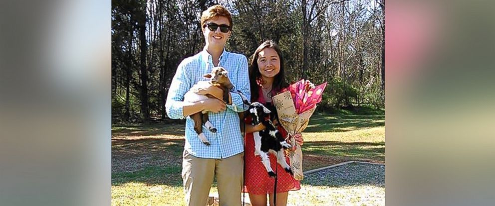 """PHOTO: A North Carolina teen asked out a girl to the prom using two goats from Whispering Hope Farm and a sign that said, """"Will you goat to the prom with me?"""" on Monday, March 30, 2015"""