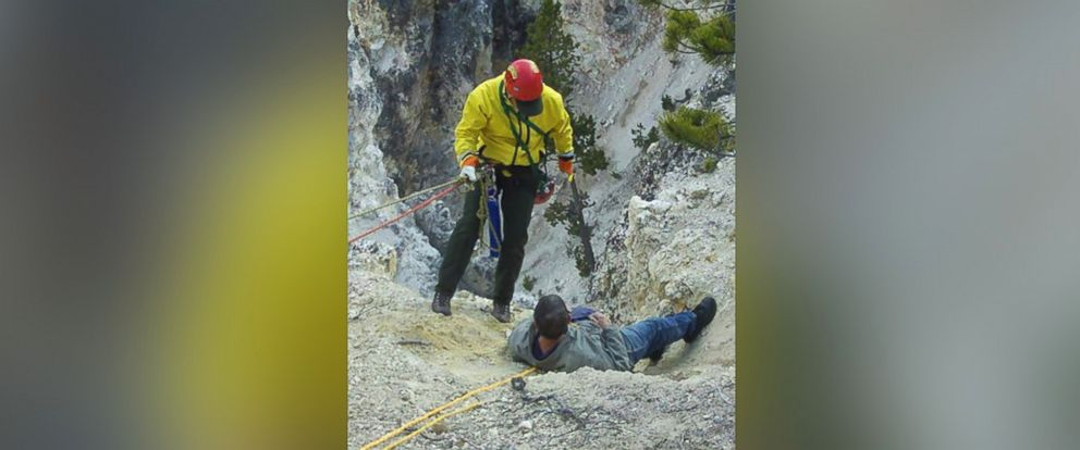 PHOTO: A member of Yellowstone National Parks Technical Rescue Team descends to help a man who slipped, May 17, 2015.