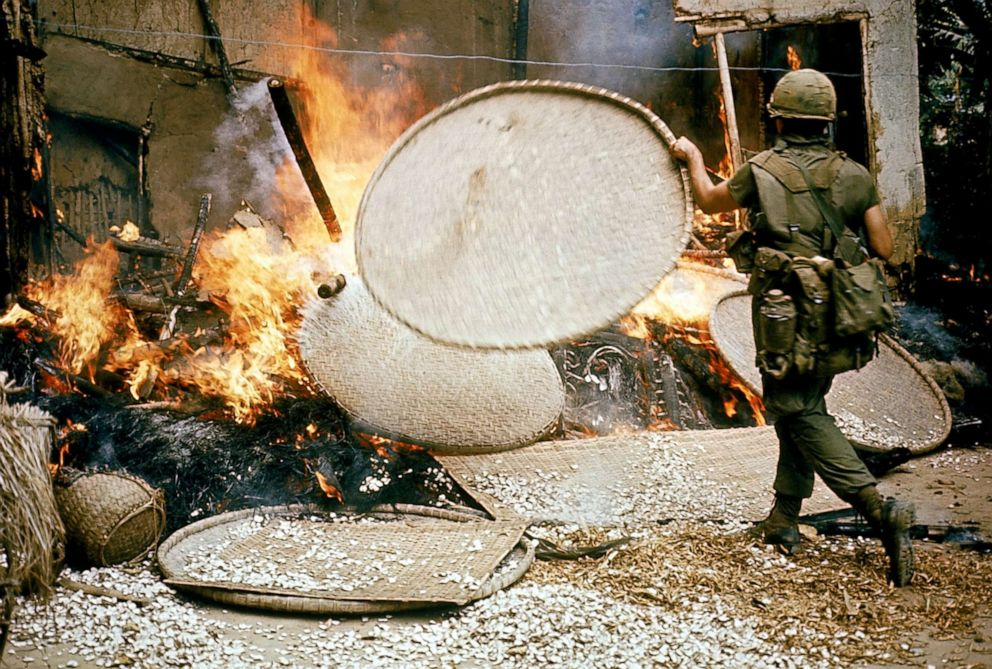 PHOTO: An American soldier burns houses during the My Lai massacre, March 16, 1968, in My Lai, South Vietnam.