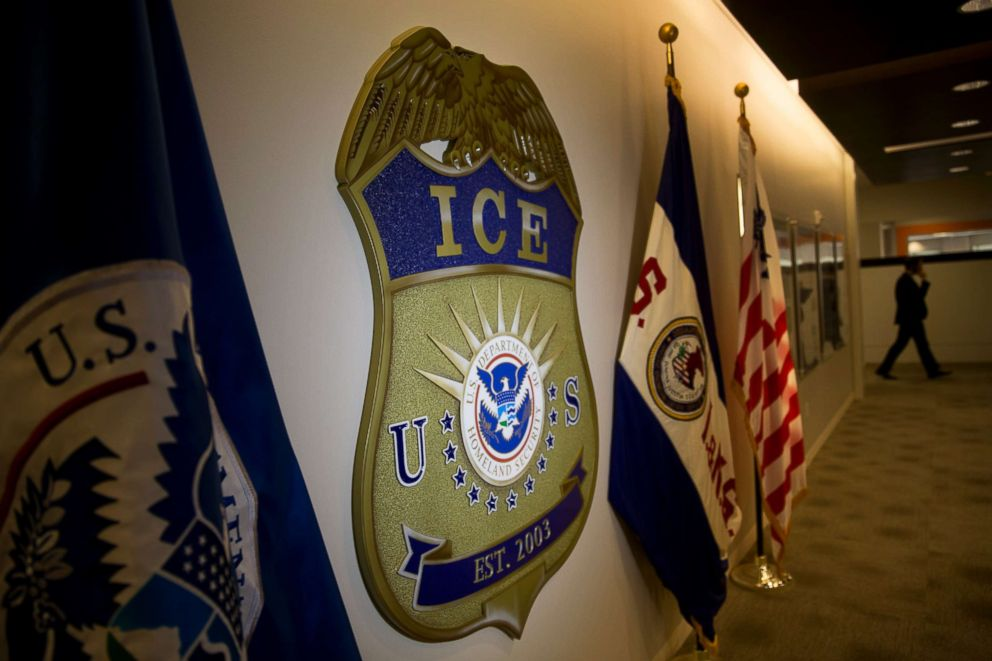 PHOTO: The U.S. Immigration and Customs Enforcement (ICE) seal hangs on a wall at the headquarters in Washington, on Nov. 20, 2014.