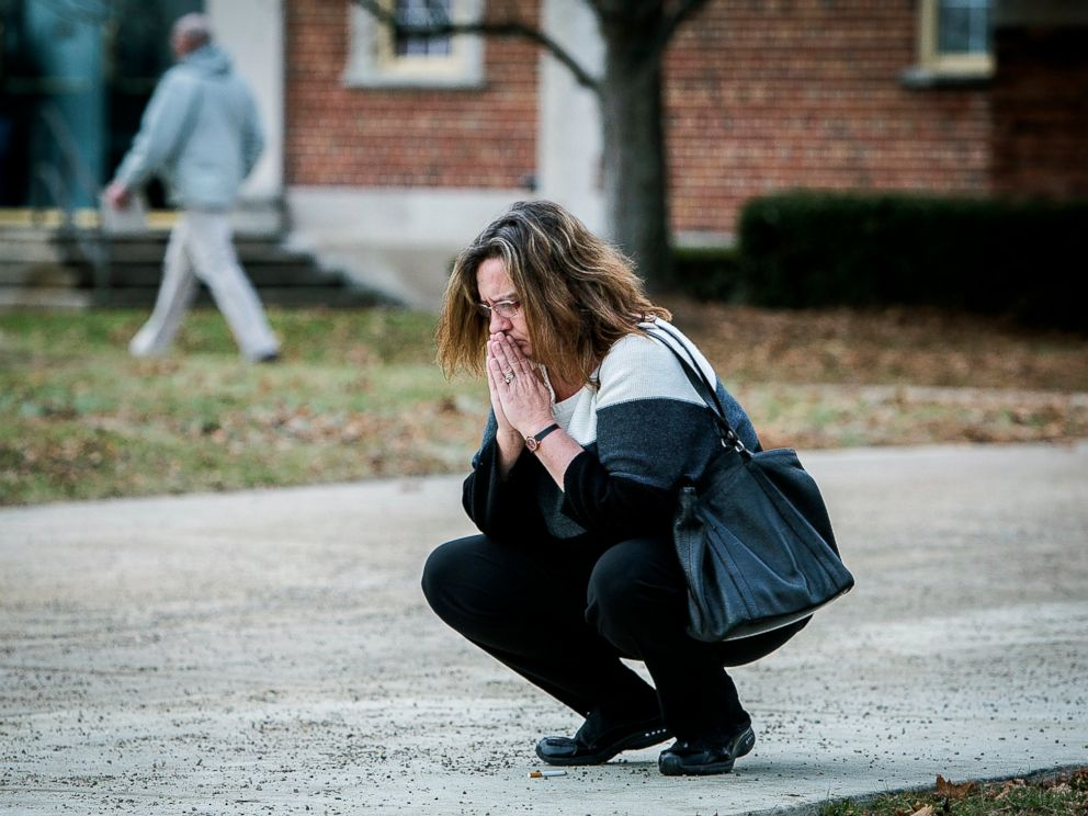 PHOTO: A parent prays outside of the Civic Hall Performing Arts Center before going inside to reunite with her child after a shooting occurred at Dennis Intermediate School, Thursday, Dec. 13 2018, in Richmond, Indiana.