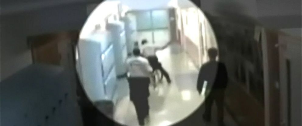 PHOTO: A security officer is seen in surveillance footage beating a student