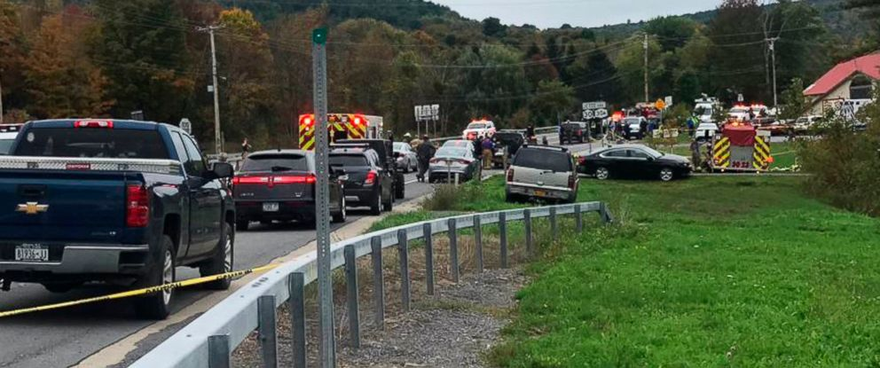 PHOTO: In this Saturday, Oct. 6, 2018 photo, emergency personnel respond to the scene of a deadly crash in Schoharie, N.Y.