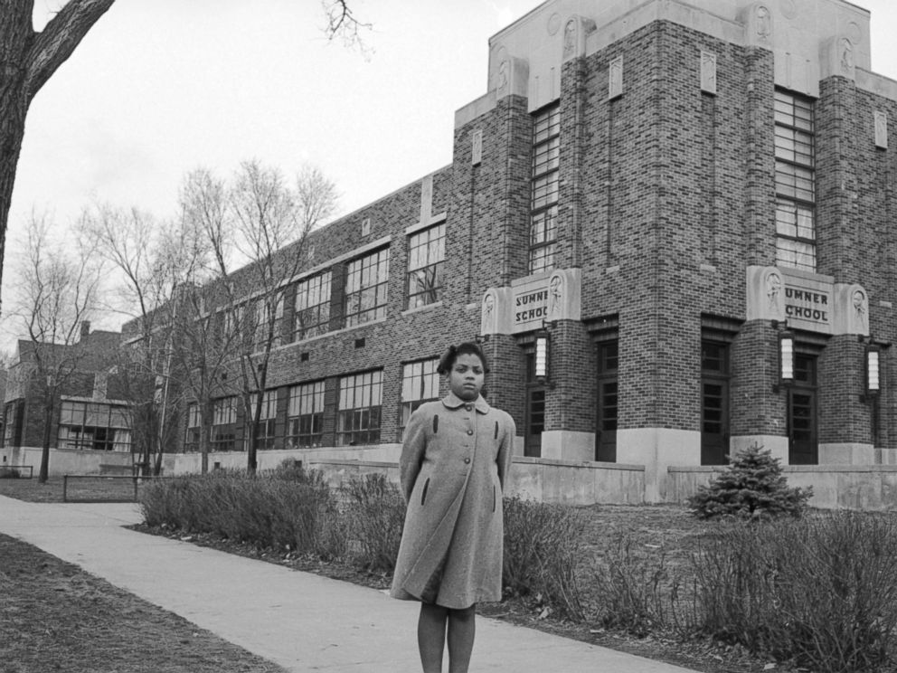 PHOTO: Nine-year-old Linda Brown poses outside Sumner Elementary School, Topkea, Kan., in 1953.