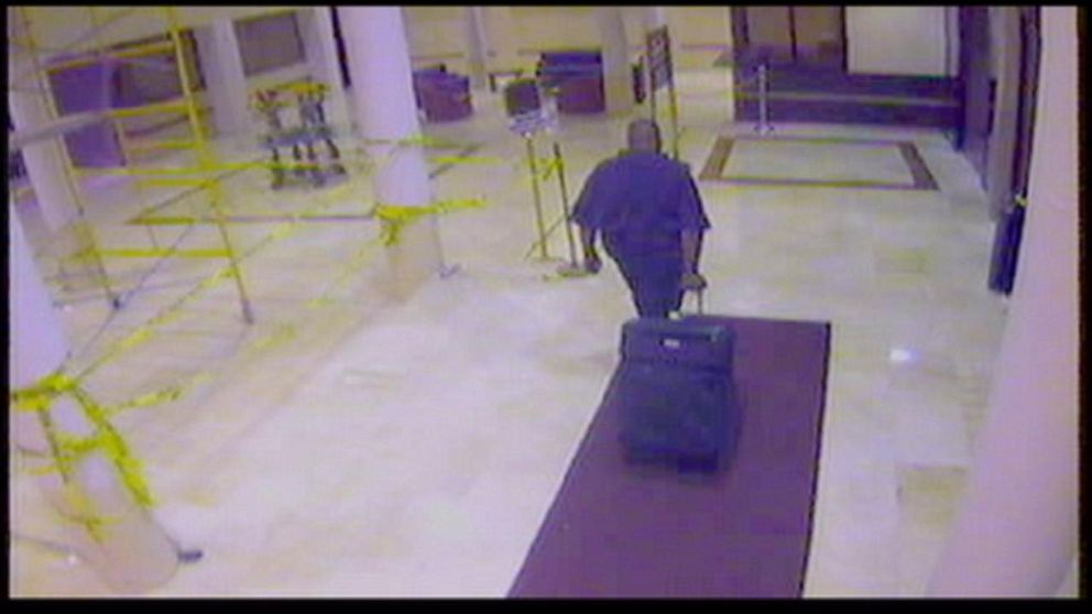 Brennan noticed a man entering the elevator with Budnytska then exiting less than two hours later with a suitcase.