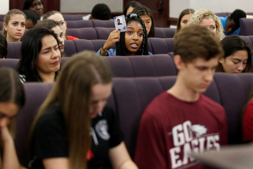 PHOTO: Tyra Hemans, a senior from Marjory Stoneman Douglas (MSD) High School, holds a photo of her friend Joaquin Oliver, who died during last weeks mass shooting on campus, as she speaks with the Florida Senate, in Tallahassee, Fla., Feb. 21, 2018.
