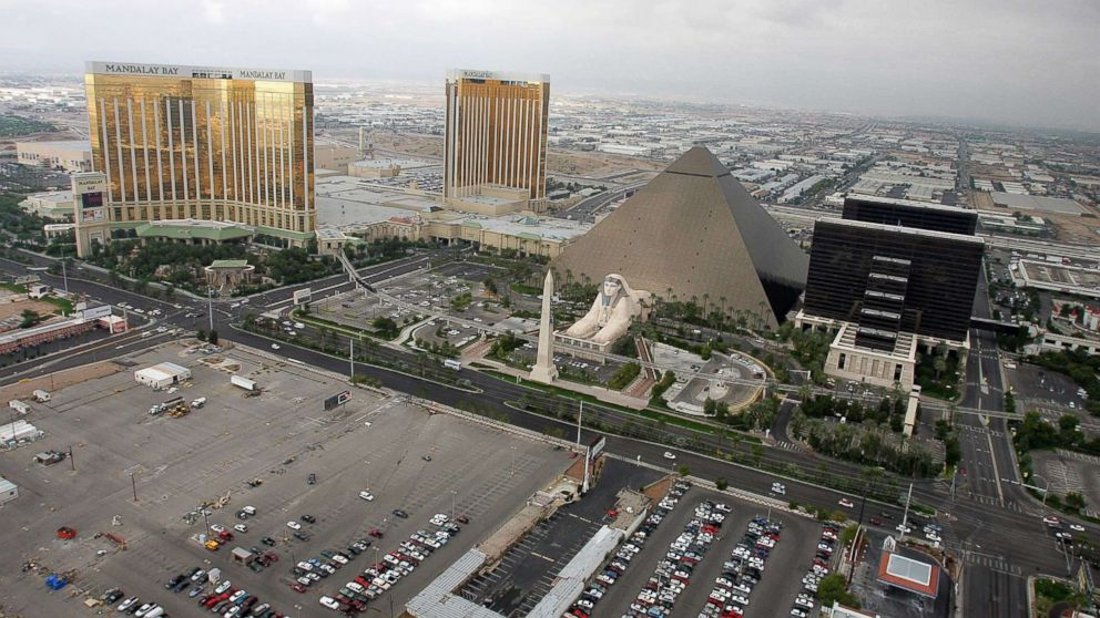 PHOTO: A 2005 file photo shows the Mandalay Bay Resort & Casino, left, the Luxor Hotel and Casino, right, and the lot where concertgoers were shot during a mass shooting on Oct. 1, 2017 in Las Vegas, Nevada.