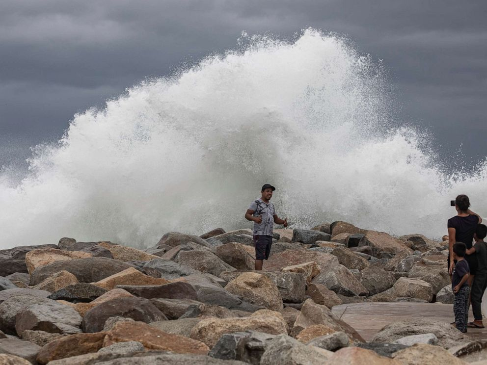 PHOTO: A tourist poses for a photo in front breaking waves before the expected arrival of Hurricane Lorena, in Los Cabos, Mexico, Friday, Sept. 20, 2019.