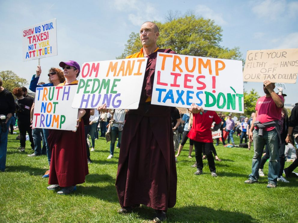 PHOTO: Buddhist monk Jampal Rowe of Poolesville, Md., attends the Tax March rally on the west lawn of the Capitol to call on President Trump to release his tax returns, April 15, 2017, in Washington.