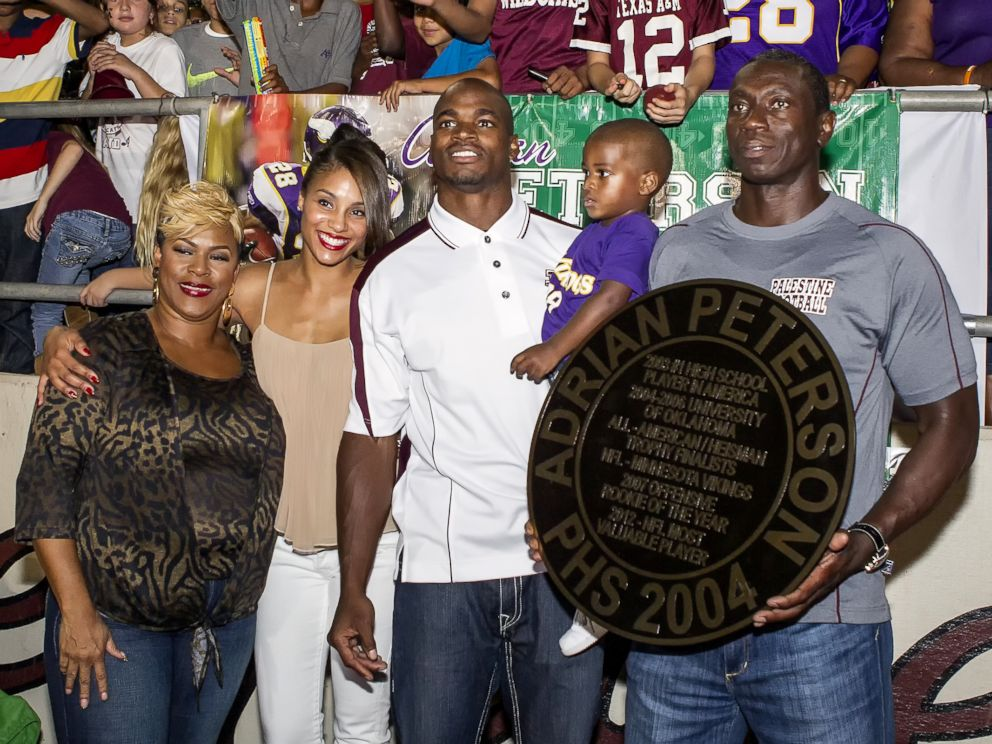 PHOTO: Adrian Peterson and his family retire his high school football uniform at Palestine High School in Palestine, Texas, Oct. 4, 2013.