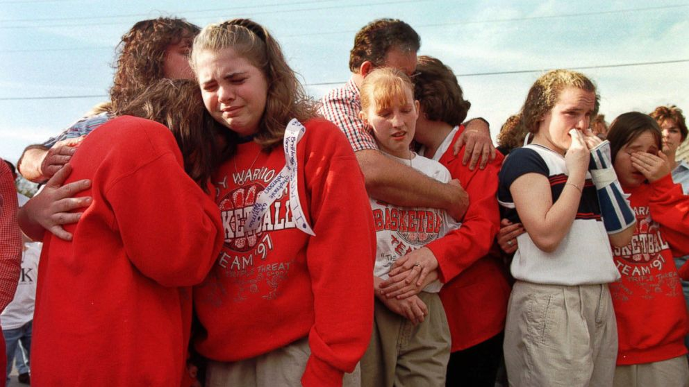 Westside Middle School students gathered in the parking lot of a radio station, March 26, 1998, to hear a tribute song to the children who died in a shooting at the school near Jonesboro, Ark.
