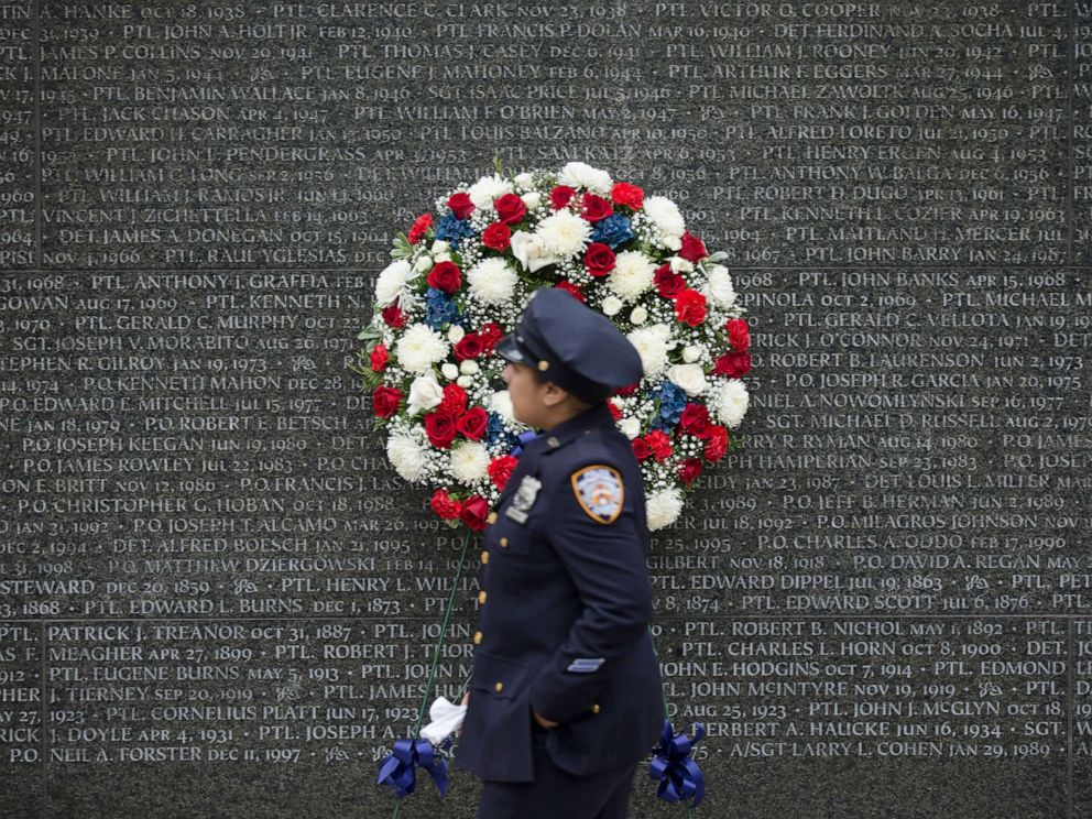 PHOTO: A police officer walks along the NYC Police Memorial wall during a NYPD memorial ceremony in the Battery Park City neighborhood of N.Y., in this Oct. 10, 2014 file photo.