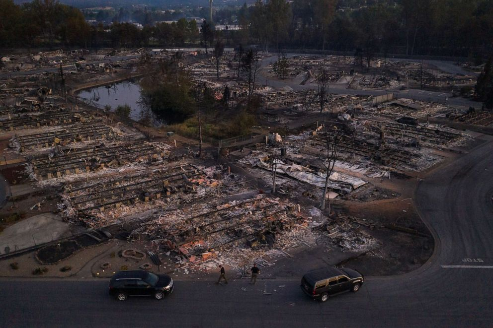 PHOTO: Security officials survey the Bear Lakes Estates neighborhood which was left devastated by the Almeda fire in Phoenix, Oregon, U.S., September 9, 2020.