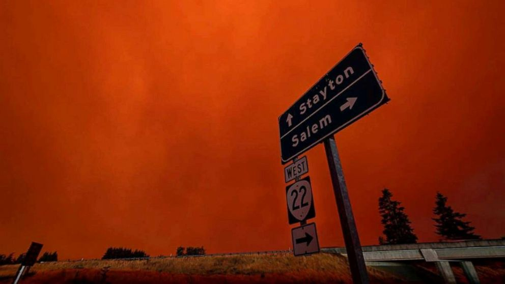 PHOTO: Red sky and thick smoke are seen in Salem City, Oregon, U.S., September 8, 2020, in this picture obtained from social media. Picture taken September 8, 2020.