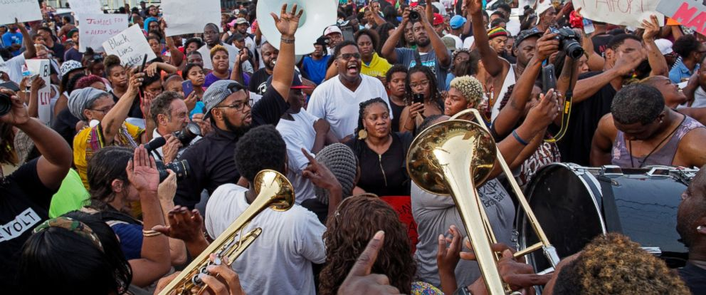PHOTO: A second line brass band arrives at the Triple S convenience store July 6, 2016, were a vigil to honor Alton Sterling, a black man who was shot and killed there by Baton Rouge Police on Tuesday, was held.