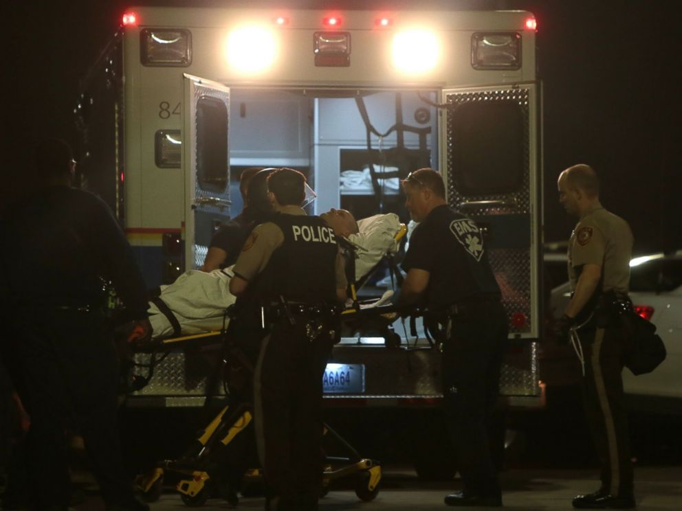 PHOTO: Paramedics load one of two police officer who were shot while standing guard in front of the Ferguson Police Station during a protest, March 12, 2015.