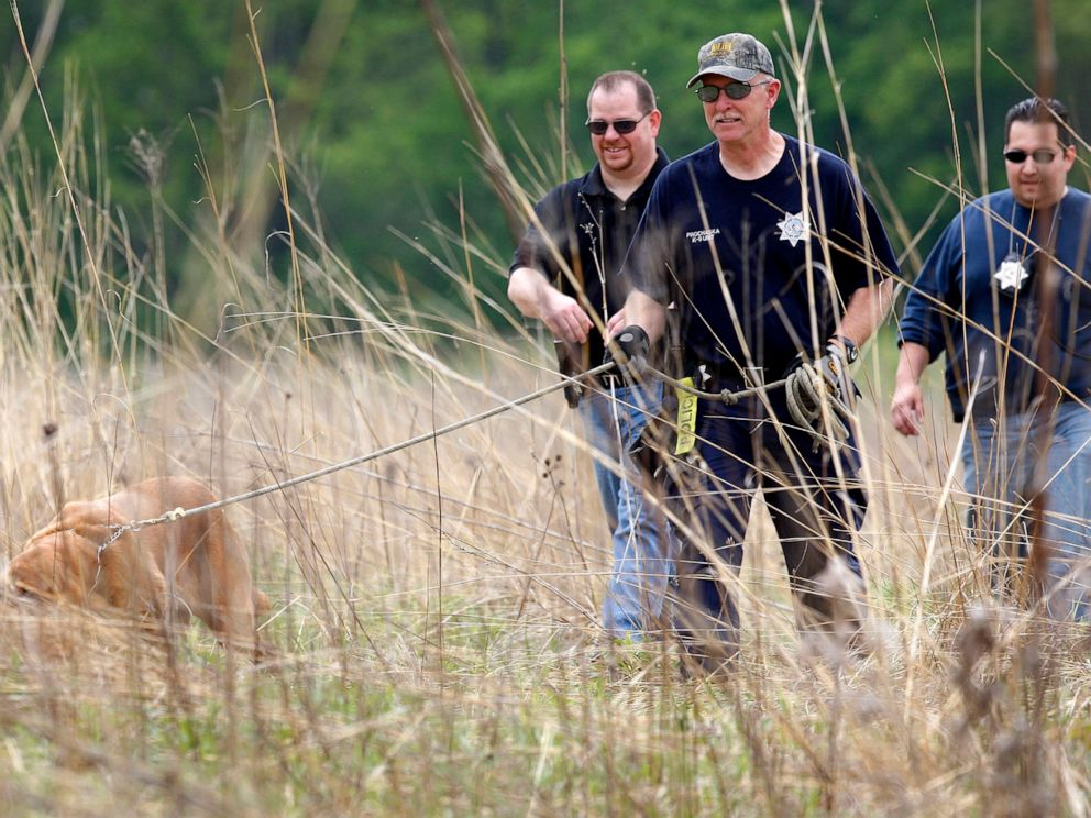 PHOTO: Joliet Police search Castle Rock State Park wetlands for evidence in Timmothy Pitzens disappearance, May 19, 2011.