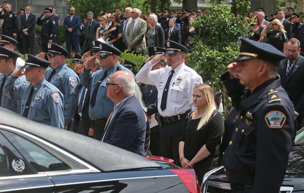PHOTO: Hundreds of police officers stood at attention and saluted in front of the Cathedral Basilica of St. Louis as the body of officer Michael Langsdorf was taken from the church at the end of the funeral mass on July 1, 2019, in St. Louis.