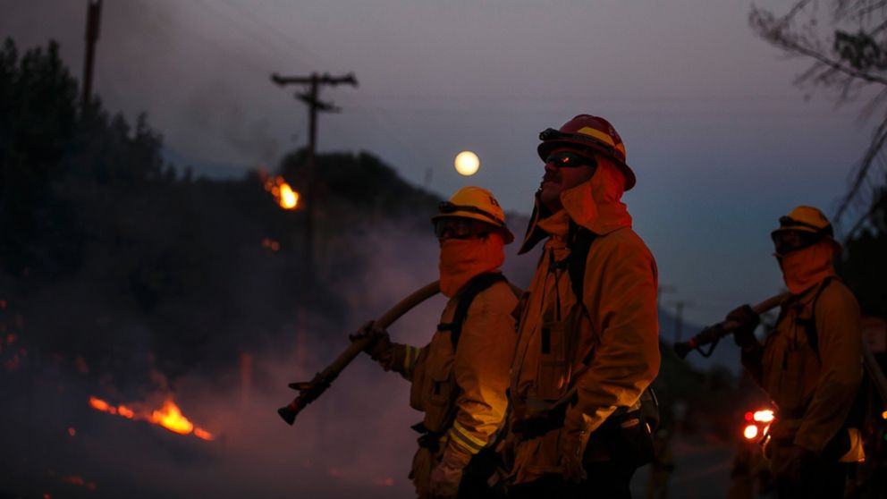 Firefighters monitor the Blue Cut fire on the side of Lytle Creek Road, August 17, 2016, San Bernardino County, California.