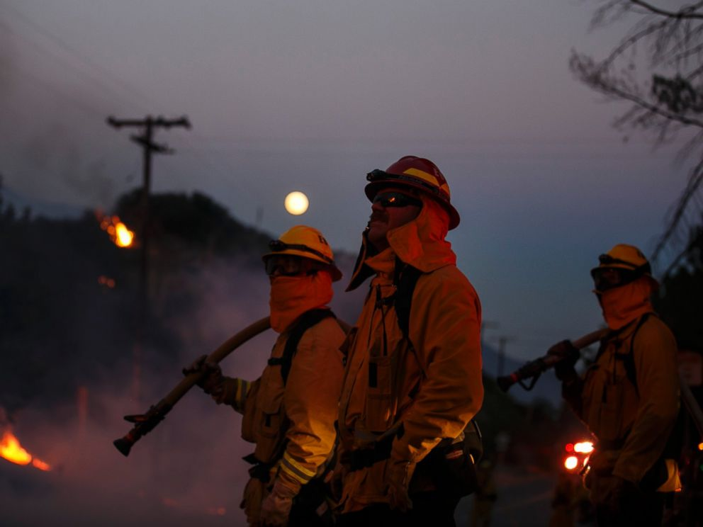 PHOTO: Firefighters monitor the Blue Cut fire on the side of Lytle Creek Road, August 17, 2016, San Bernardino County, California.