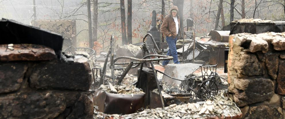 PHOTO: Local resident Ralph Cogdill checks the debris of his house which was ruined by a wildfire in Pigeon Forge, Sevier County, Tennessee, on Nov. 30, 2016.
