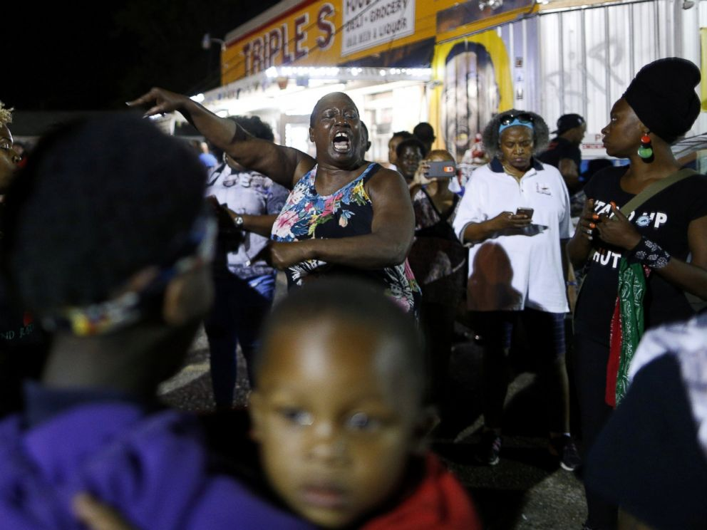 PHOTO: Alton Sterlings aunt Veda Washington-Abusaleh speaks to community members during a vigil at the Triple S Food Mart, in Baton Rouge, Louisiana, on May 2, 2017.