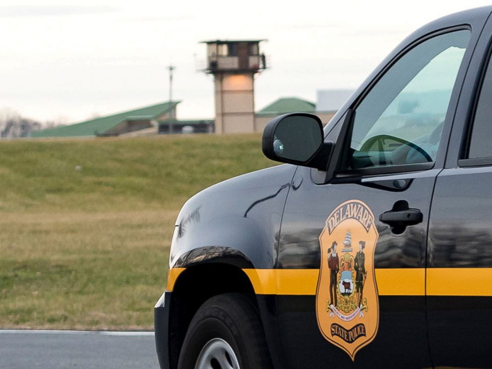 PHOTO: A Delaware State Police vehicle overlooks the James T. Vaughn Corrections Center during a lockdown where hostages were taken in an incident at the mens prison in Smyrna, Delaware, Feb. 1, 2017.