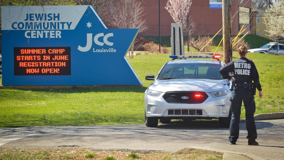 A police officer blocks an entrance as officials respond to a bomb threat at the Jewish Community Center in Louisville, Ky., March 8, 2017.