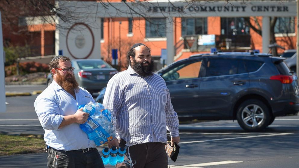 Rabbis with the local community share water with first responders as local and federal officers respond to the bomb threat at the Jewish Community Center in Louisville, Ky., March 8, 2017.