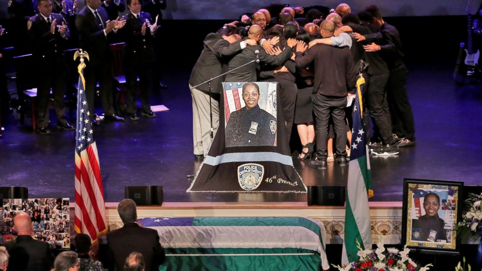 The family of New York City Police Department (NYPD) officer Miosotis Familia hug during her funeral at the World Changers Church in the Bronx borough of New York City, July 11, 2017.