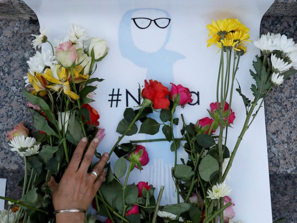 PHOTO: An attendee leaves flowers for Nabra Hassanen, a teenage Muslim girl killed by a bat-wielding motorist near a Virginia mosque, during a vigil in New York City, June 20, 2017.