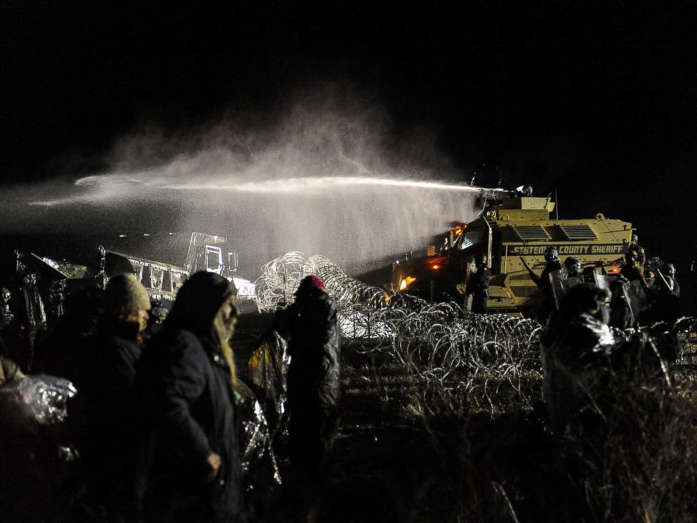 PHOTO: Police use a water cannon on protesters during a protest against plans to pass the Dakota Access pipeline near the Standing Rock Indian Reservation, North Dakota, Nov. 20, 2016.