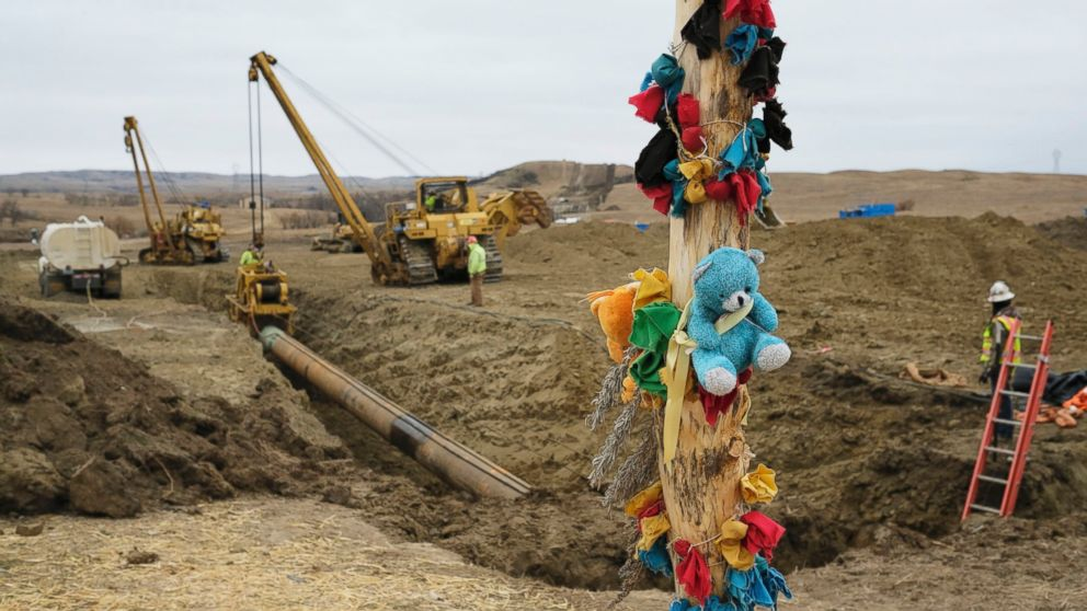 A log adorned with colorful decorations remains at a Dakota Access Pipeline protest encampment as construction work continues on the pipeline near the town of Cannon Ball, North Dakota, Oct. 30, 2016.