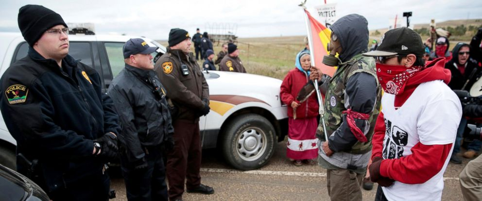 PHOTO: Dakota Access Pipeline protesters square off against police between the Standing Rock Reservation and the pipeline route outside the little town of Saint Anthony, North Dakota, Oct. 5, 2016.