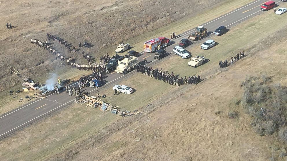 Protesters against the Dakota Access Pipeline stand-off with police in this aerial photo of Highway 1806 and County Road 134 near the town of Cannon Ball, North Dakota, Oct. 27, 2016.