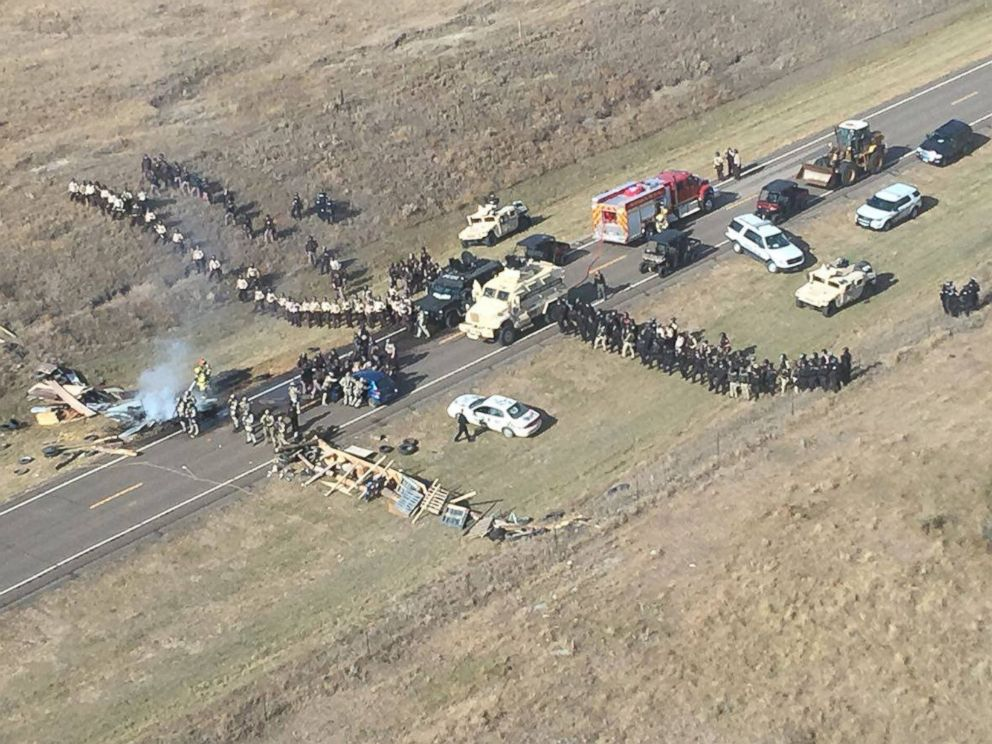 PHOTO: Protesters against the Dakota Access Pipeline stand-off with police in this aerial photo of Highway 1806 and County Road 134 near the town of Cannon Ball, North Dakota, Oct. 27, 2016.