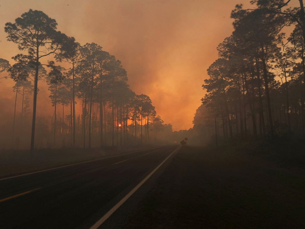 PHOTO: Smoke is seen during sunset as the West Mims fire burns in the Okefenokee National Wildlife Refuge in Georgia, in a photo released April 29, 2017.