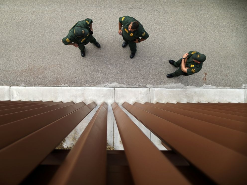 PHOTO: Border patrol agents stand next to a border fence used for training at the United States Border Patrol Academy in Artesia, New Mexico, June 8, 2017.