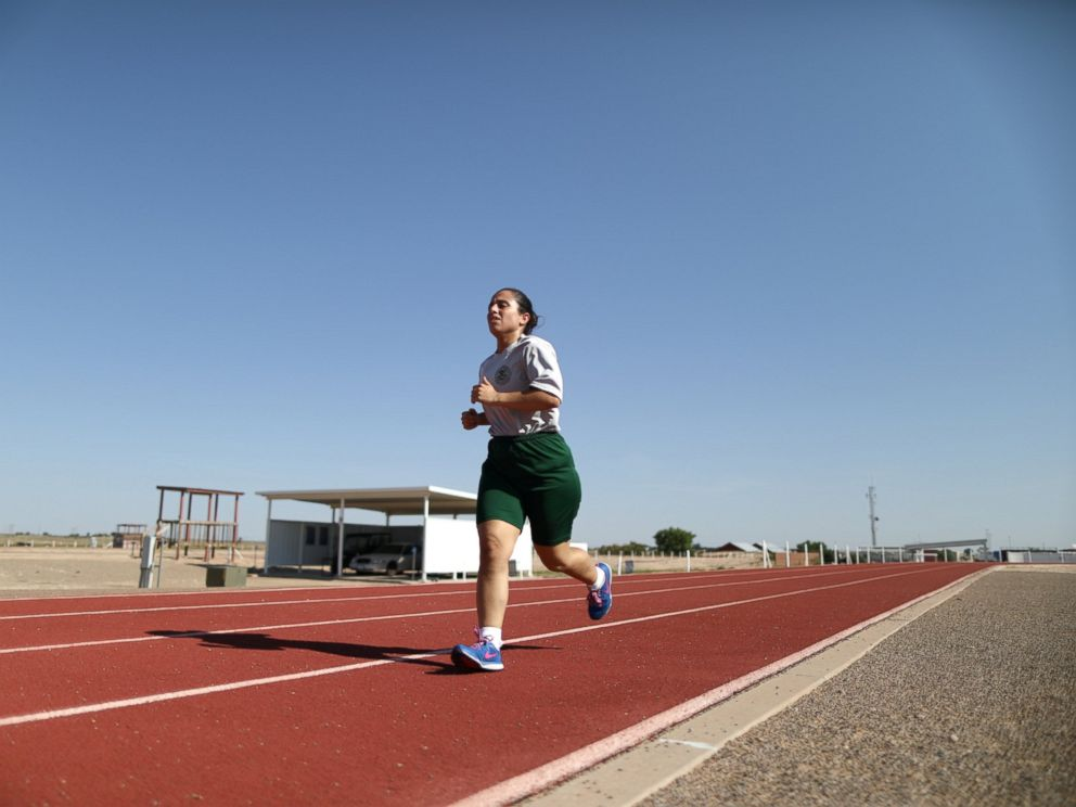PHOTO: Border patrol trainee Stevany Shakare, from Iraq, runs during physical training class at the United States Border Patrol Academy in Artesia, New Mexico, June 9, 2017.