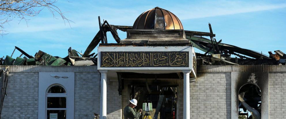 PHOTO: A security official investigates the aftermath of a fire at the Victoria Islamic Center mosque in Victoria, Texas Jan. 29, 2017.