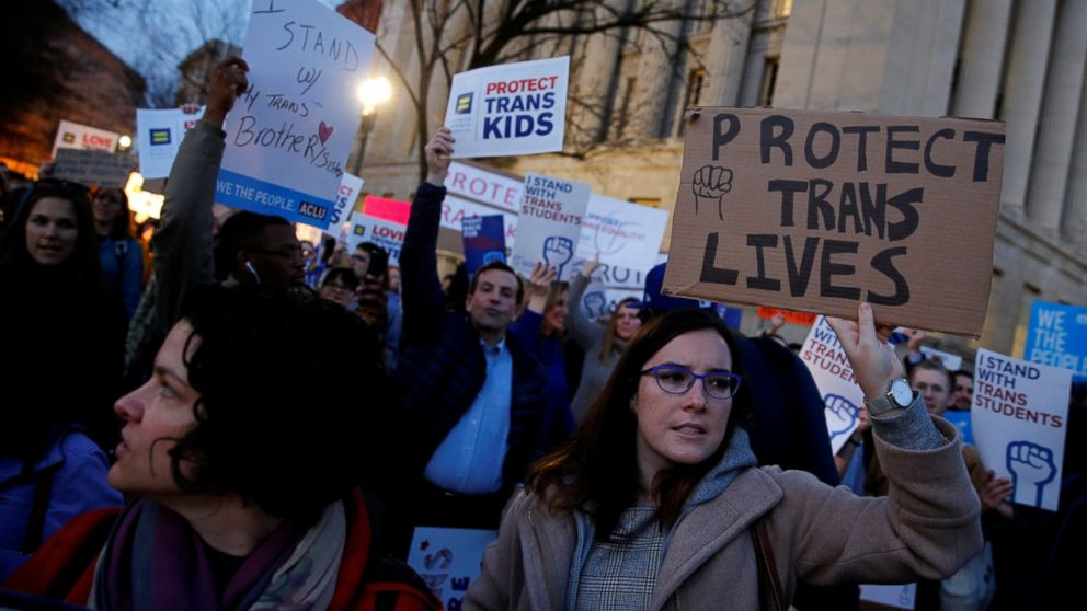 Transgender activists and supporters protest potential changes by the Trump administration in federal guidelines issued to public schools in defense of transgender student rights, near the White House in Washington, Feb. 22, 2017.