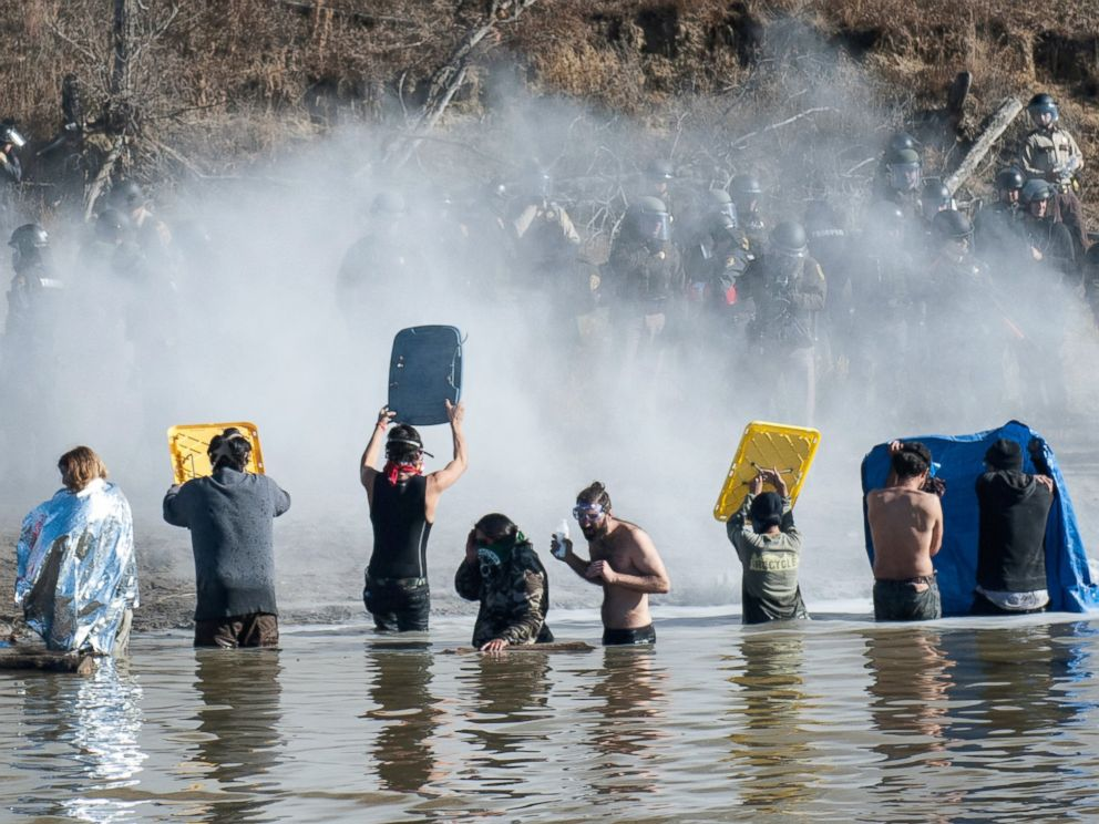 PHOTO: Police use pepper spray against protestors standing in the water of a river during a protest against the building of a pipeline near the Standing Rock Indian Reservation near Cannonball, North Dakota, Nov. 2, 2016.