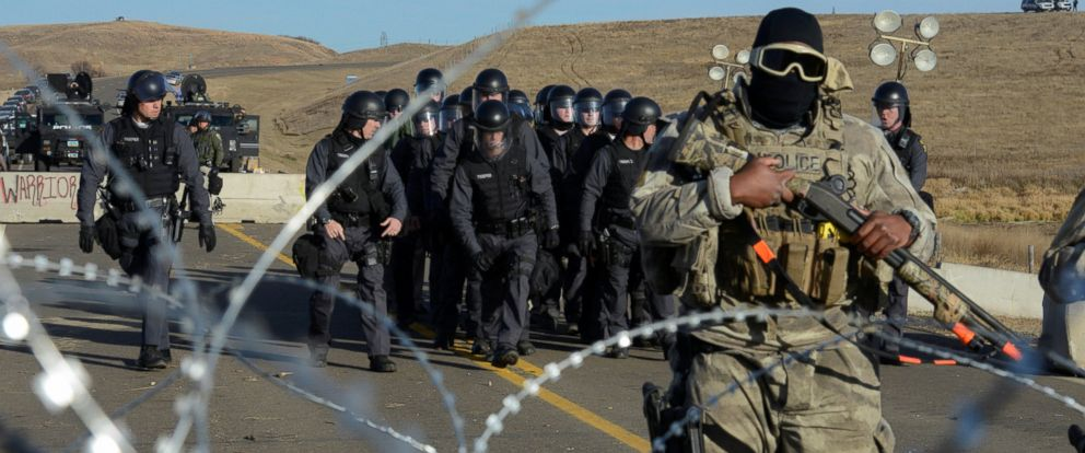 PHOTO: Police stand guard during a stand off with protesters on a bridge during a protest of the Dakota Access pipeline on the Standing Rock Indian Reservation near Cannon Ball, North Dakota Nov. 6, 2016.