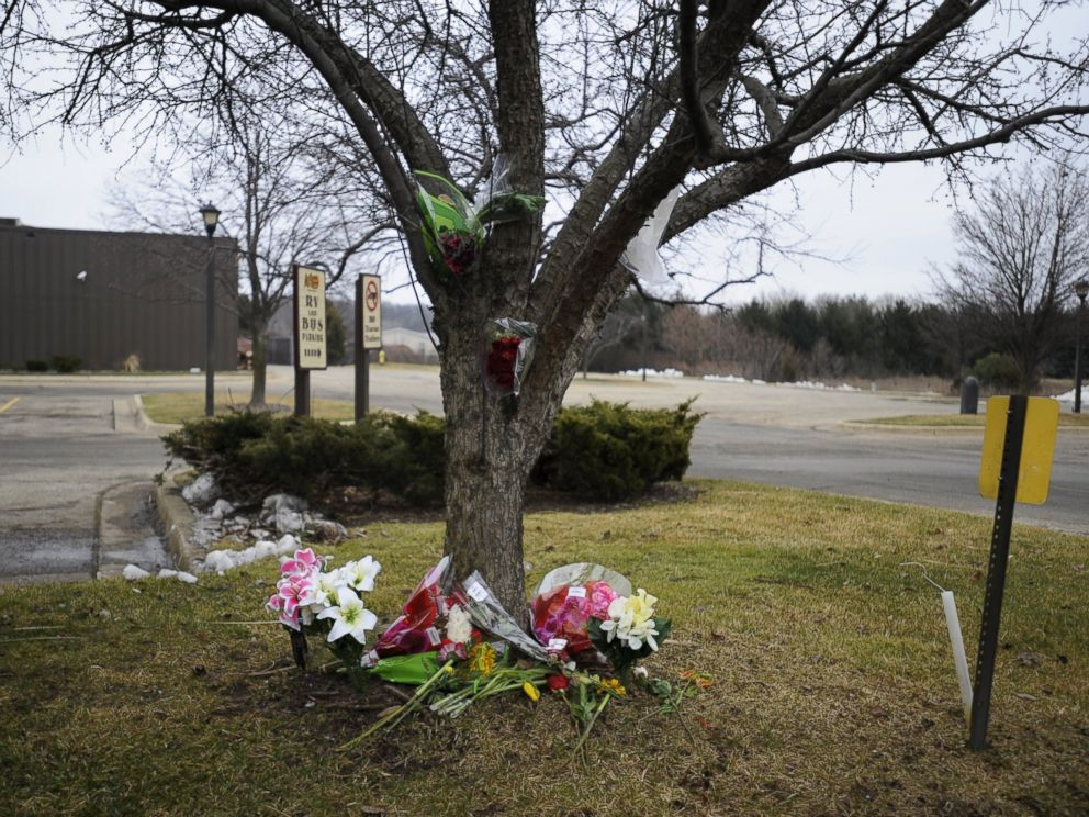 PHOTO: Flowers lay at a makeshift memorial outside a Cracker Barrel restaurant, one of the sites of a series of shootings over the weekend that killed six in Kalamazoo, Michigan, February 22, 2016.