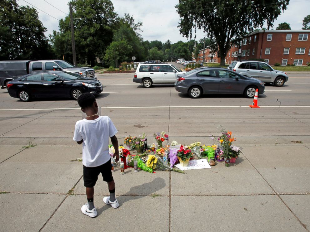 PHOTO: A boy stands at a make-shift memorial at the site of the police shooting of Philando Castile in Falcon Heights, Minnesota, July 7, 2016.