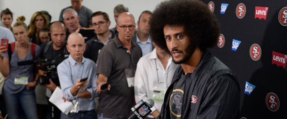 PHOTO: San Francisco 49ers quarterback Colin Kaepernick talks to the media after the game against the San Diego Chargers at Qualcomm Stadium, on Sept. 1, 2016, in San Diego.