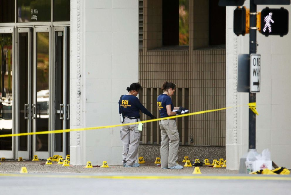 PHOTO: FBI investigators look over the crime scene in Dallas, July 8, 2016, following a shooting incident that killed five police officers.