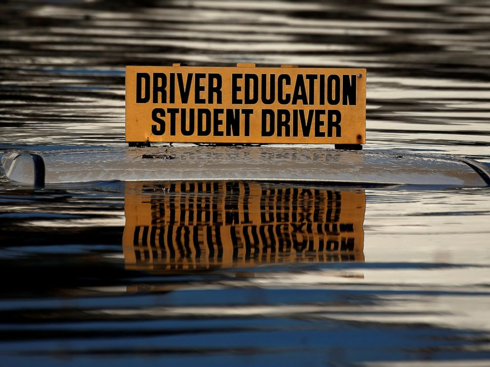 PHOTO: The roof of a student driver car is pictured partly underwater as a result of Hurricane Matthew in Lumberton, North Carolina, on Oct. 10, 2016.